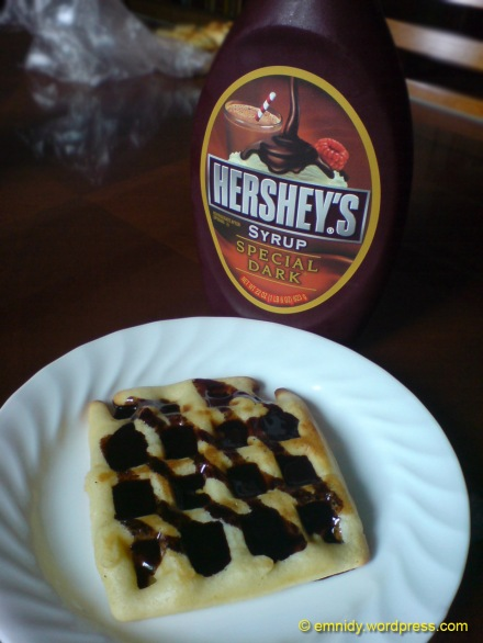 chocolate syrup on waffles